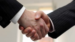Businessmen shake hands.