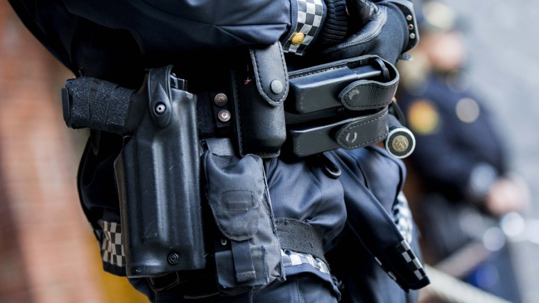Armed police outside Oslo City Hall