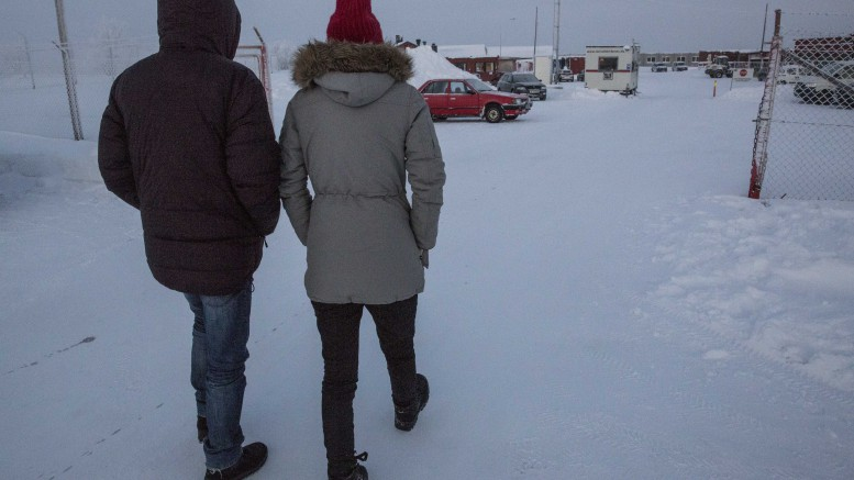 2 peoples walking in the snow