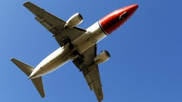 A Norwegian plane on the way to landing at the Oslo airport Gardermoen