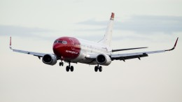 A plane from Norwegian goes in for landing at Oslo Airport
