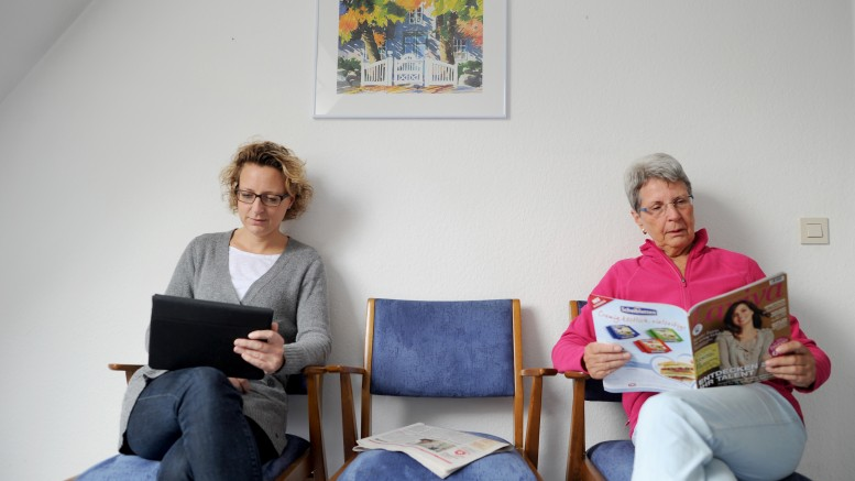Two women at the doctor. The waiting room.