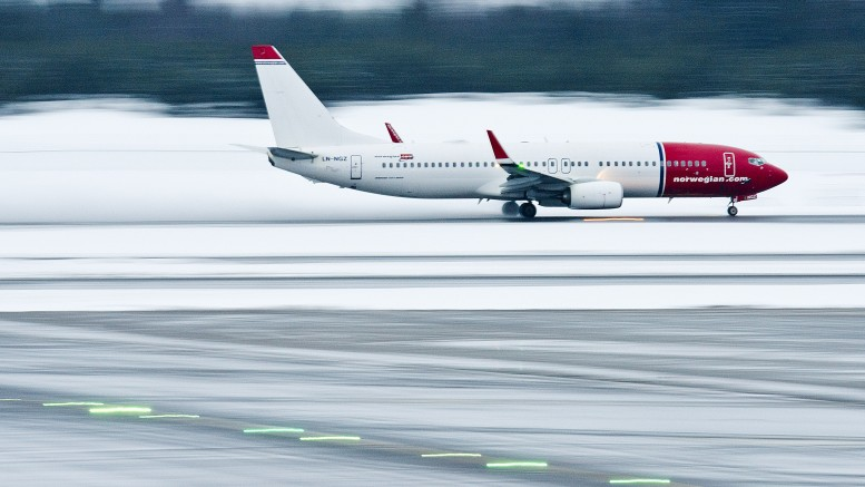A Norwegian plane takes off from Oslo Airport