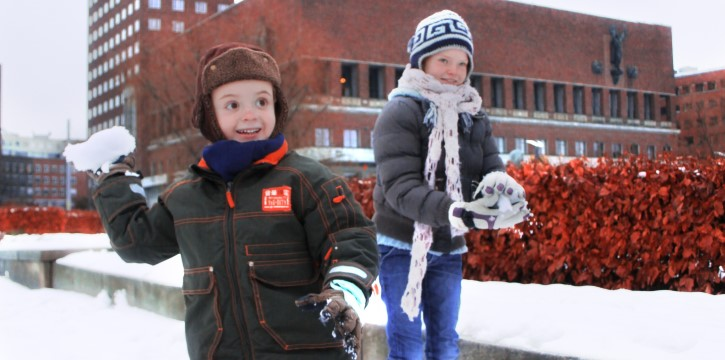 Winter children in front of Oslo City Hall