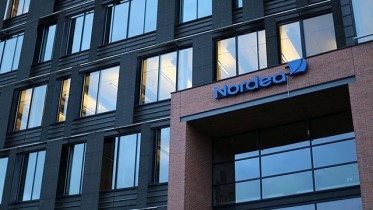 Nordea lowers interest rates financial support wage growth