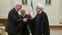 Iranian President Hassan Rouhani (R) shakes hands with German Foreign Minister Frank-Walter