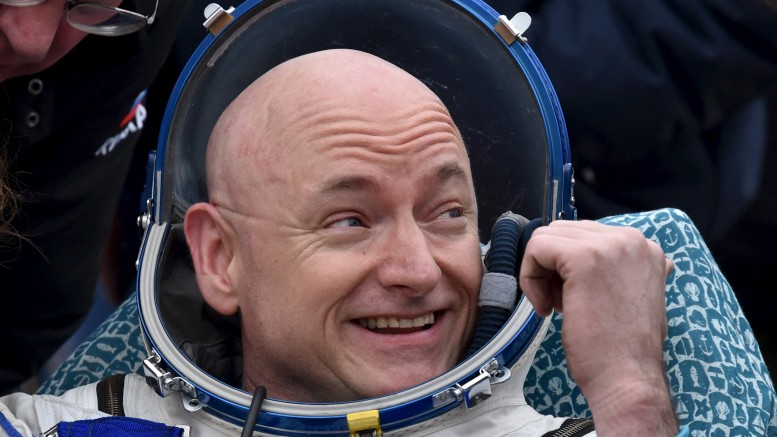 U.S. astronaut Scott Kelly reacts shortly after landing near the town of Dzhezkazgan