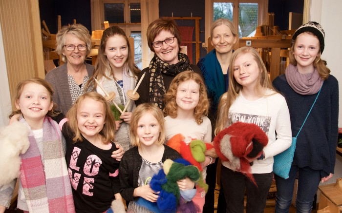 Young teaches needlework older
