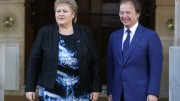 Norway's Prime Minister Erna Solberg (L) is met by Britain's Foreign Office minister Hugo Swire