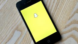 Mobile phone with the symbol for Snapchat