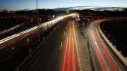 Lit torches along the E18 in the during the event Light for reflection in Stokke in Vestfold