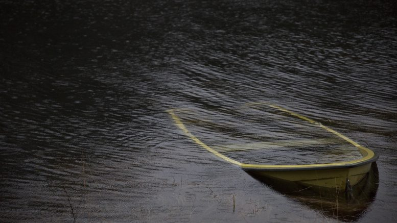 A small boat sinking