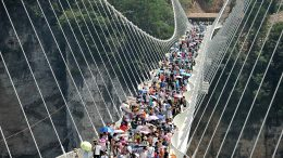 People visit a glass bridge