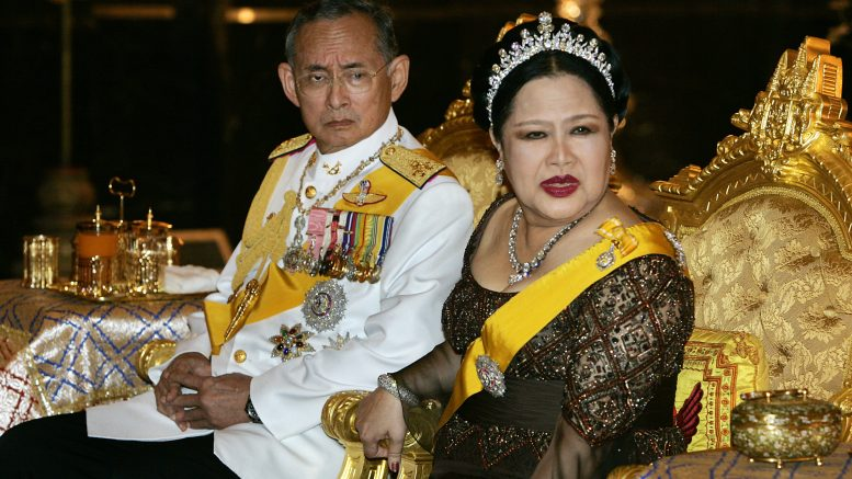 King Bhumibol and his wife Queen Sirikit Holdt