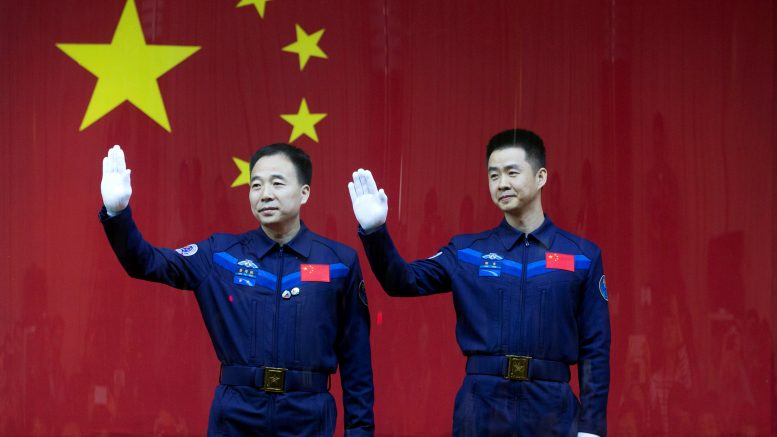 Chinese astronauts Jing Haipeng (L) and Chen Dong