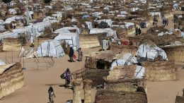 People walk inside the Muna Internally displace people camp in Maiduguri, Nigeria