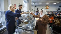 Crown Prince Haakon and Crown Princess Mette-Marit handed out Turkey soup to Ioncila Eleondra from Romania and other poor