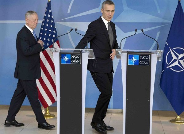 NATO Secretary General Jens Stoltenberg, right, and U.S. Secretary of Defense Jim Mattis