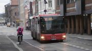 A bus and a cyclist in Skippergata in Oslo