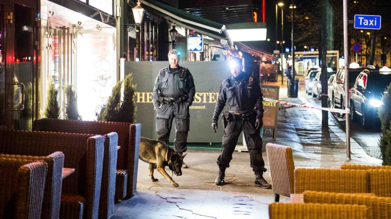 Police work outside the restaurant The Lannister