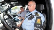 50/5000 Prime Minister Erna Solberg is sitting on a police car