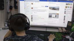 Boy with facebook on computer.