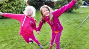 Young girls playing in the garden.