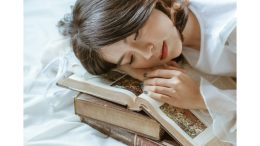 Sleeping book woman