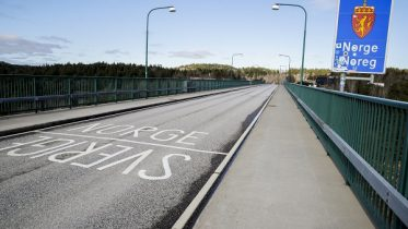 The border crossing on the old Svinesund Bridge, between Norway and Sweden.