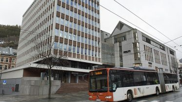 A bus passes the police station in Bergen.