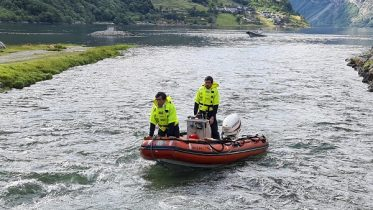 Little boy has fallen into the river in Geiranger