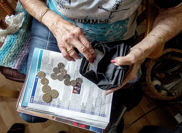 Older lady with coins and wallet.