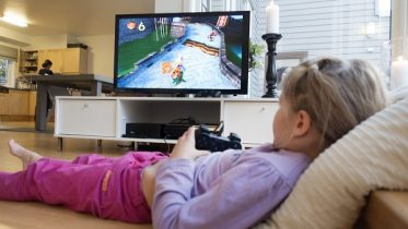 Girl playing playstation.