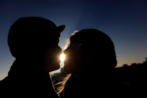 Kissing Couple against the Light