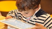 Children read on tablets